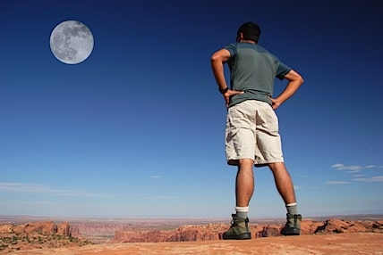 a man staring up at the moon