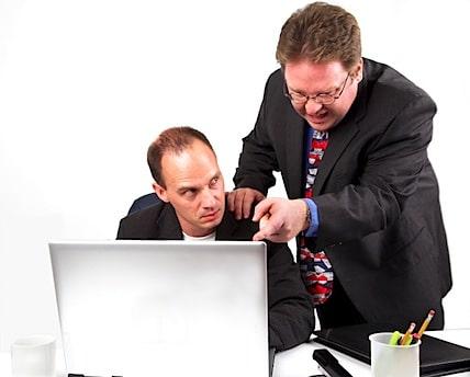 a boss micromanaging an employee