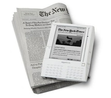 kindle sitting on top of a traditional newspaper