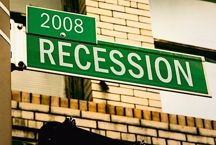 "a road sign with the words ""2008 Recession"" on it"