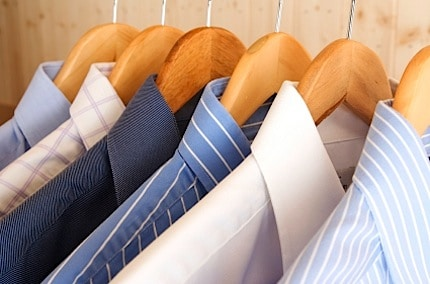 a clothes rack full of shirts neatly in a row