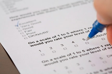 reader filling out a survey form