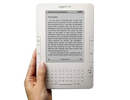 someone holding the amazon kindle 2 in their hand