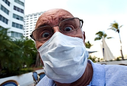 a man with a flu mask on