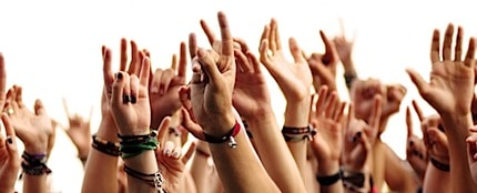 hands waving at a music concert