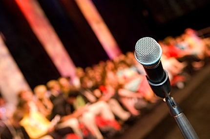 A Microphone on a Stage Where a Speaker Is About to Make a Presentation