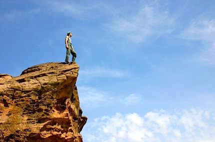 A Man Standing on a Rock Outcropping