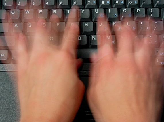 Two Hands Typing on a Keyboard Photo courtesy of ©iStockphoto.com/sdominick, Image #103597