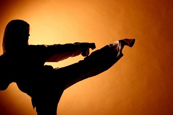 Femal Martial Artist Kicking into the Air - Photo courtesy of ©iStockphoto.com/pascalgenest, Image #1023601