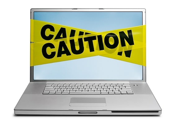 Warning Tape Wrapped Around Laptop - Photo courtesy of ©iStockphoto.com/DNY59, Image #1520756