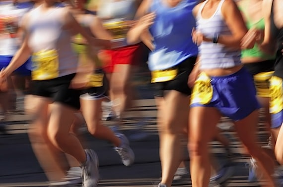 A Motion Blur of People Running a Marathon - Photo courtesy of ©iStockphoto.com/soupstock, Image #1722120