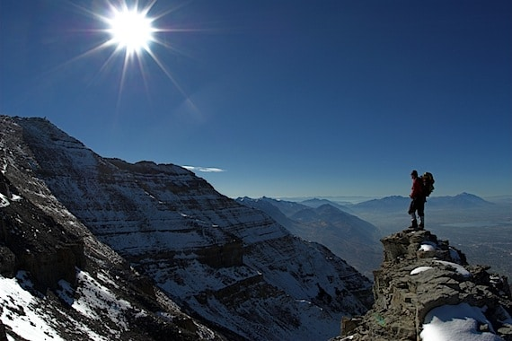 A Lone Hiker Consider the Mountain Before Him - Photo courtesy of ©iStockphoto.com/saunderman, Image #2481475