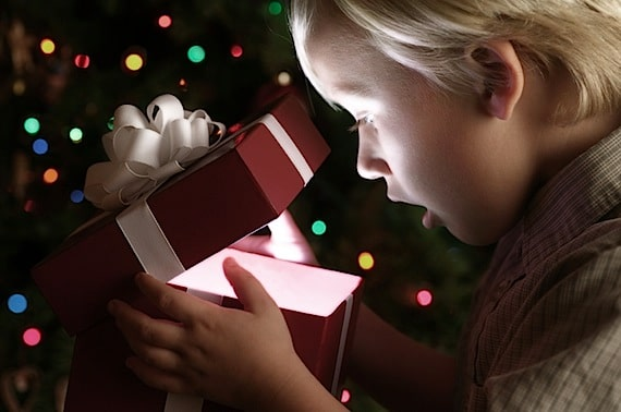 Little Boy Opening Christmas Present - Photo courtesy of ©iStockphoto.com/skodonnell, Image #2575217