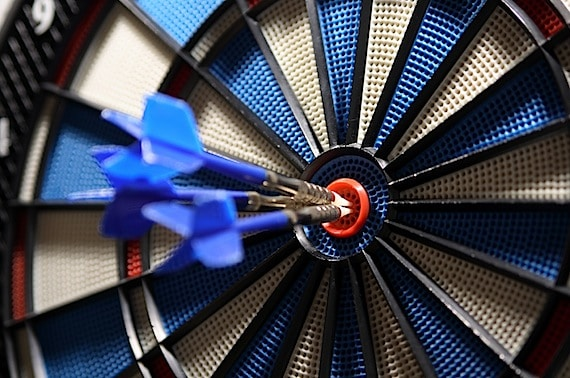 Dart in a Target Bullseye - Photo courtesy of ©iStockphoto.com/Mellimage, Image #3654703