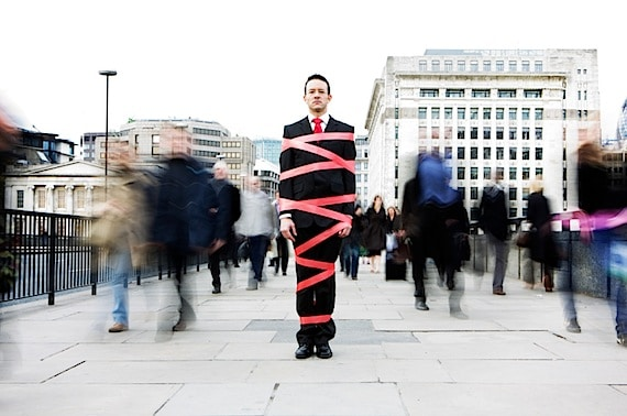 Man Tied Up in Red Tape - Photo courtesy of ©iStockphoto.com/track5, Image #5867991