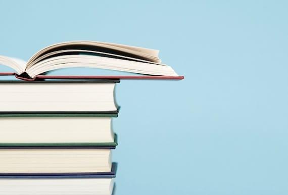 Pile of books one opened - Photo courtesy of ©iStockphoto.com/Deejpilot, Image #5972800
