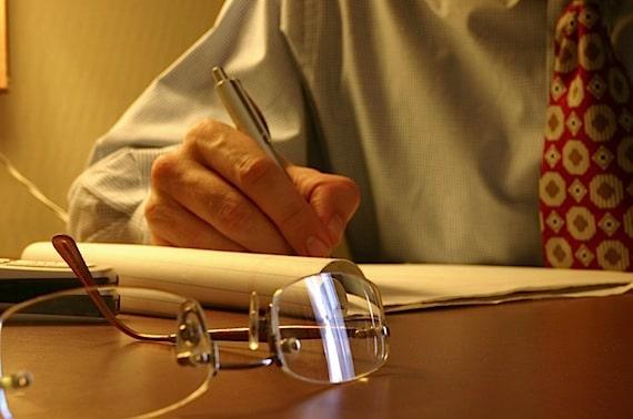 Man Writing on a Legal Pad - Photo courtesy of ©iStockphoto.com/RBFried, Image #666501