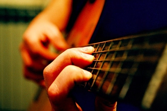Someone Playing the Guitar - Photo courtesy of ©iStockphoto.com/damircudic, Image #1116206