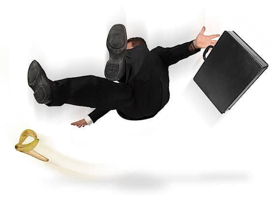 Businessman Slipping and Falling - Photo courtesy of ©iStockphoto.com/jgroup, Image #3091176
