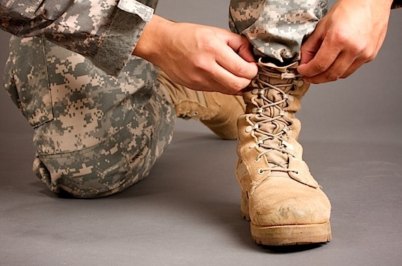 A soldier Lacing Up His Boots - Photo courtesy of ©iStockphoto.com/carlofranco, Image #8614676
