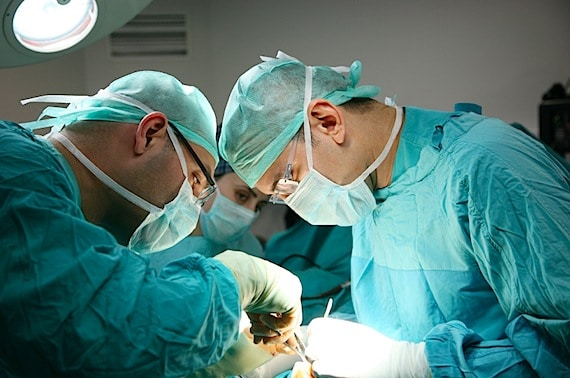 Doctors Performing an Operation - Photo courtesy of ©iStockphoto.com/LionHector, Image #8683429
