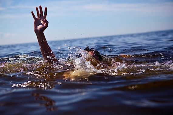 A Drowning Man, Struggling to Survive - Photo courtesy of ©iStockphoto.com/Anton_Sokolov, Image #10025070