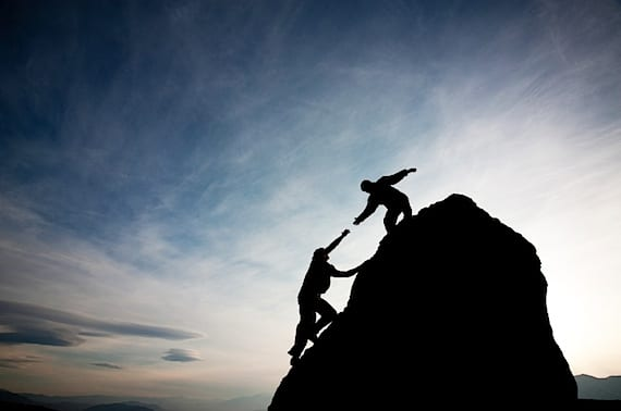 Friends Helping Each Other Climb - Photo courtesy of ©iStockphoto.com/, Image #11493906