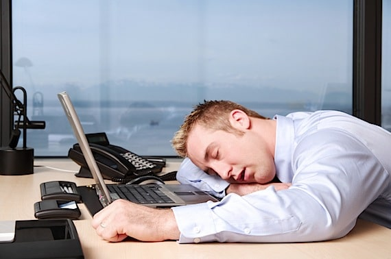 A Man Sleeping on His Computer - Photo courtesy of ©iStockphoto.com/jhorrocks, Image #5058401