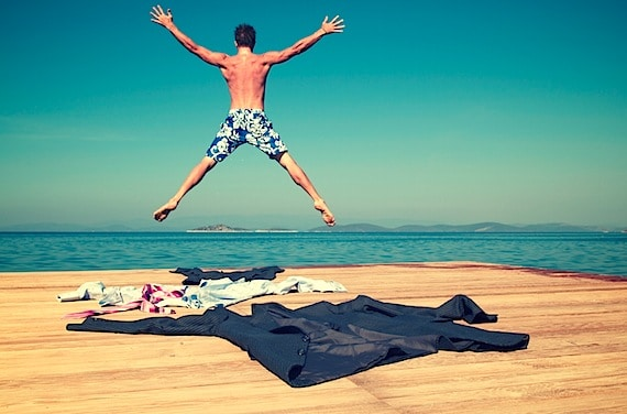 Business man stripped to his shorts and jumping off a dock - Photo courtesy of ©iStockphoto.com/PeskyMonkey, Image #11582459