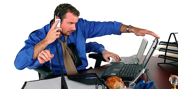 A Very Busy Man Attempting to Multi-Task To Get It All Done - Photo courtesy of ©iStockphoto.com/tzara, Image #250015