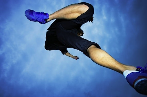 A Runner Jumping into the Air - Photo courtesy of ©iStockphoto.com/caracterdesign, Image #1831312