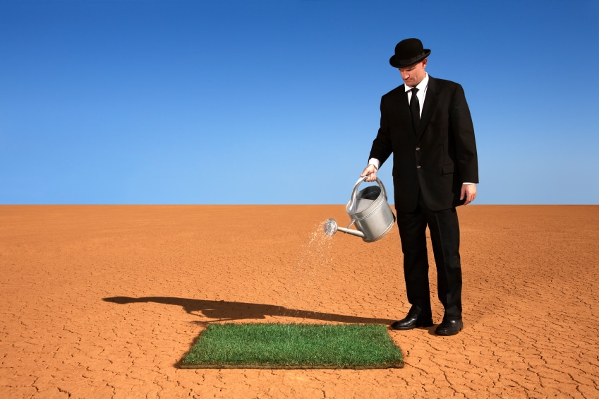 Businessman Watering Grass in the Desert - Photo courtesy of ©iStockphoto.com/skodonnell, Image #7597823