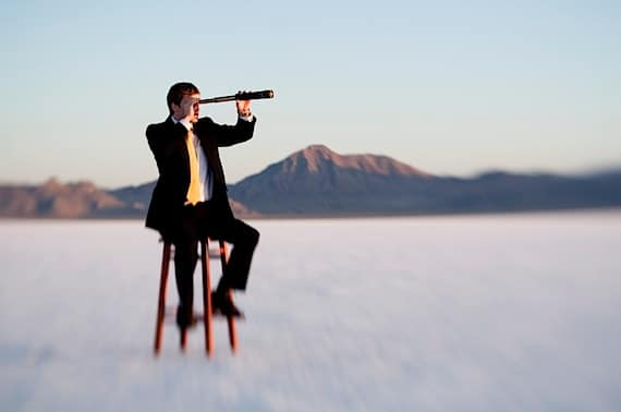 Man Above the Clouds, Perring Through a Telescope - Photo courtesy of ©iStockphoto.com/RichVintage, Image #3598020