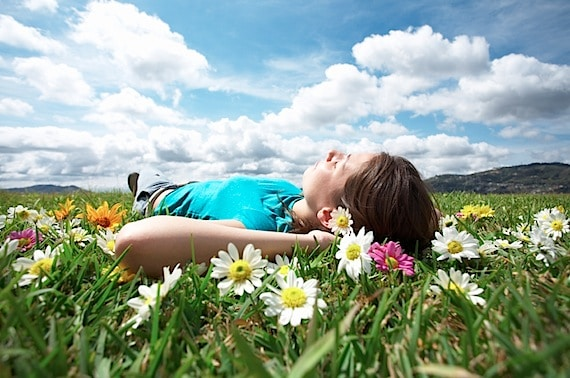 A Man Laying on the Grass Dreaming  - Photo courtesy of ©iStockphoto.com/ALEAIMAGE, Image #5724729