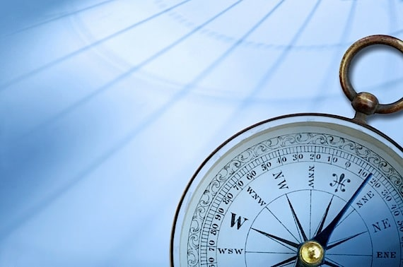 A Compass with Map Background - Photo courtesy of ©iStockphoto.com/DNY59, Image #7346114