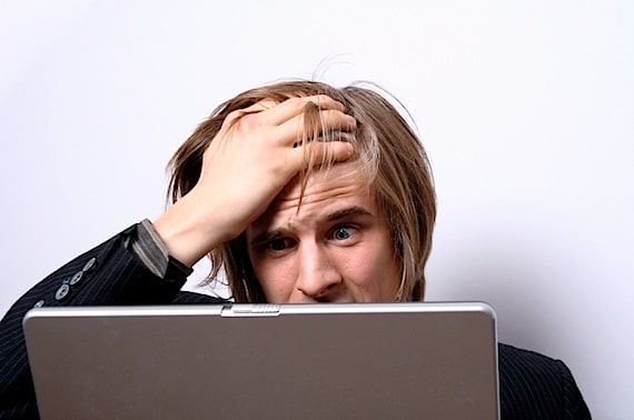 A Frustrated Man Sitting in Front of His Computer - Photo courtesy of ©iStockphoto.com/szelmek, Image #2512608