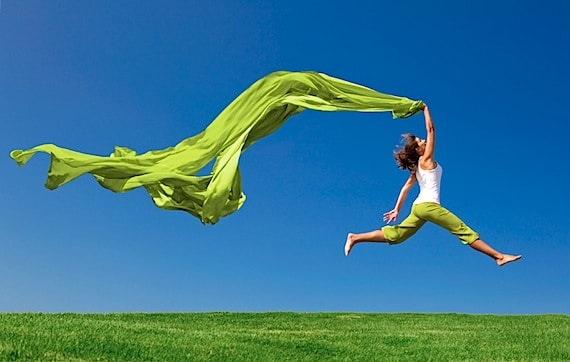 Beautiful Young Woman Jumping on a Green Meadow with a Colored Scarf - Photo courtesy of ©iStockphoto.com/erikreis, Image #12345727