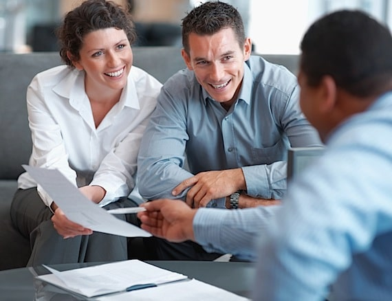 A Financial Advisor Helping a Couple with Their Financial Planning - Photo courtesy of ©iStockphoto.com/Yuri_Arcurs, Image #12401349