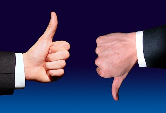 Two Thumbs, One Up and One Down - Photo courtesy of ©iStockphoto.com/hatman12, Image #3657557
