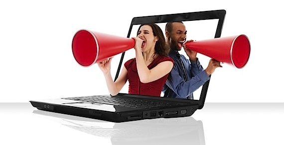 Two People with Megaphones Yelling from a Laptop - Photo courtesy of ©iStockphoto.com/YanC, Image #5946391