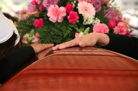 A Family Tenderly Remembers the Passing of a Loved One - Photo courtesy of ©iStockphoto.com/Kameleon007, Image #6322443