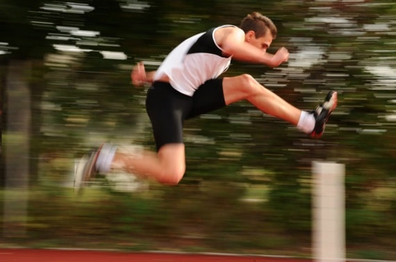 Runner Jumping Over a Hurdle - Photo courtesy of ©iStockphoto.com/technotr, Image #7292467