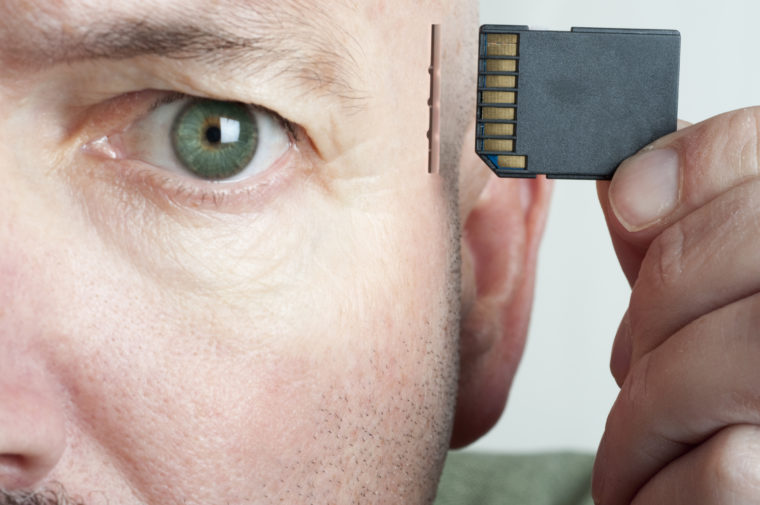 """A memory card and slot in a human head serve as a metaphor for computing, memory enhancement, artificial intelligence, etc.  Studio RAW shot converted with 16 bit processing.  Adobe RGB."""