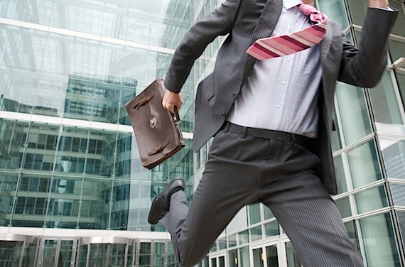 A Businessman Rushing Our of the Office with His Briefcase - Photo courtesy of ©iStockphoto.com/PeskyMonkey, Image #9381744