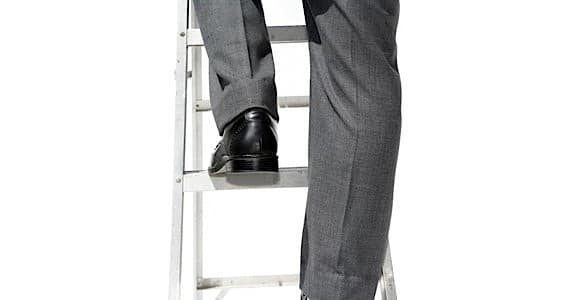 Man Climbing a Corporate Ladder - Photo courtesy of ©iStockphoto.com/ftwitty, Image #10153626