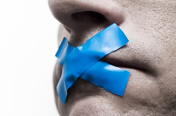 Man with Blue Tape on His Mouth - Photo courtesy of ©iStockphoto.com/paxi, Image #1719342