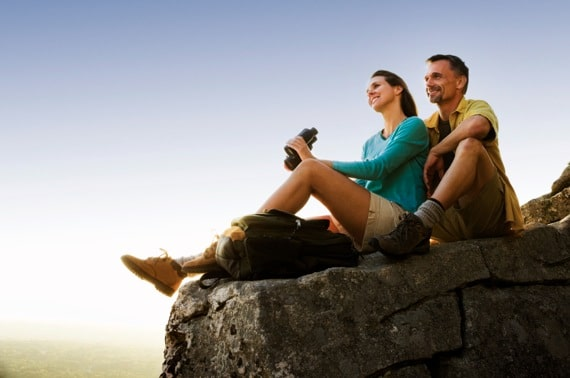 Couple Sitting On a Mountain Top After a Hike - Photo courtesy of ©iStockphoto.com/stevecoleccs, Image #8171245