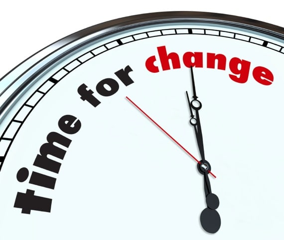 A Clock with the Hands Pointing to the Words Time for Change - Photo courtesy of ©iStockphoto.com/iqoncept, Image #11038062
