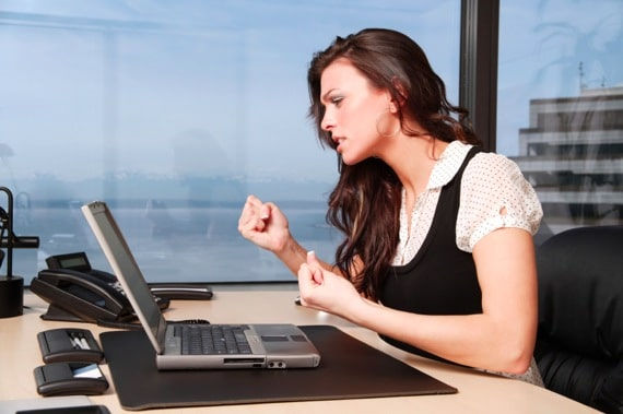 A Young Woman Looking at Her Computer in Frustration - Photo courtesy of ©iStockphoto.com/jhorrocks, Image #3175196