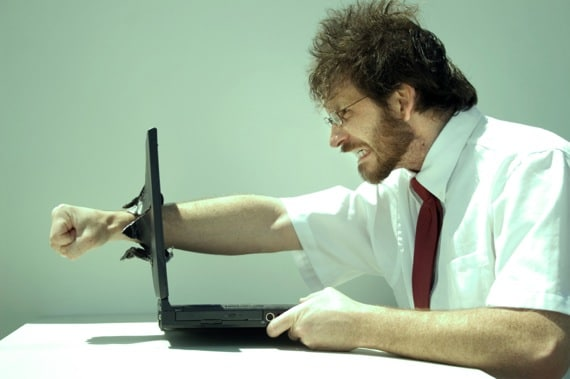 A Man Punching His Fist Through His Laptop Computer - Photo courtesy of ©iStockphoto.com/clintspencer, Image #3237600